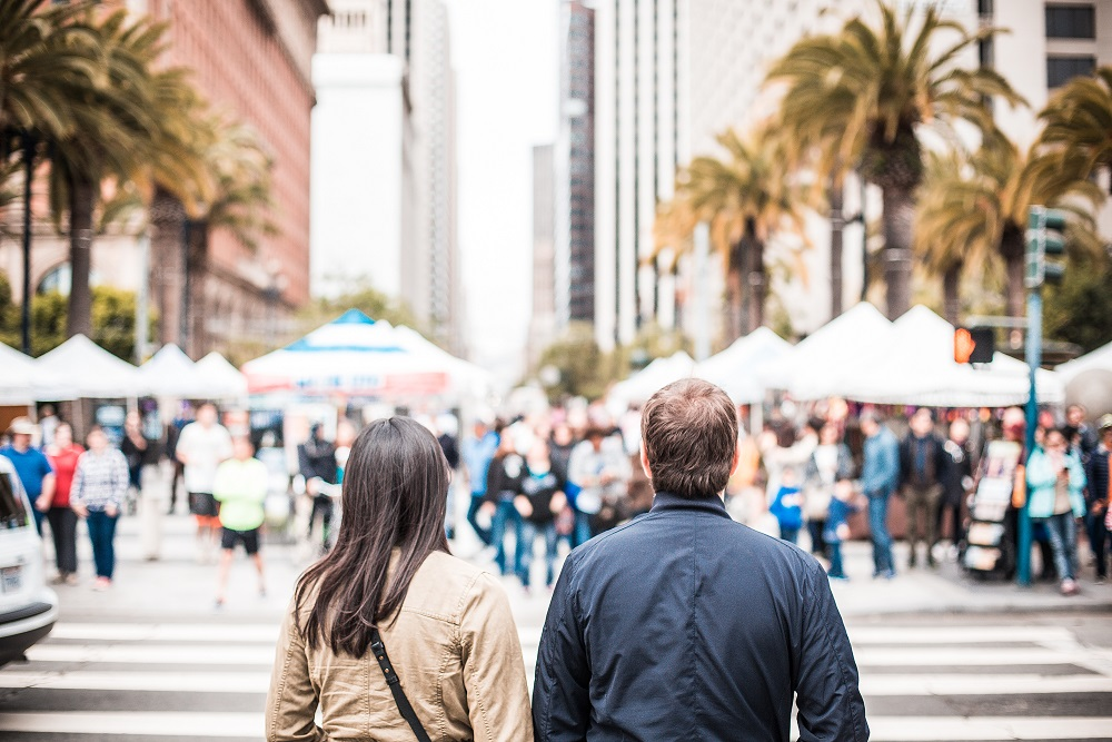 young-couple-looking-on-the-other-side-of-the-crosswalk-picjumbo-com